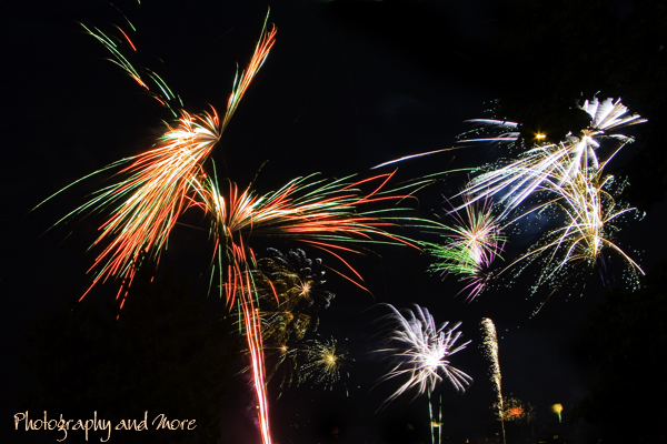 multiple colorful fireworks - how to photograph fireworks