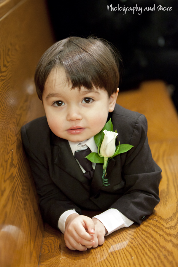 Photograph 1 Flower boy resting on the church bench before the ceremony
